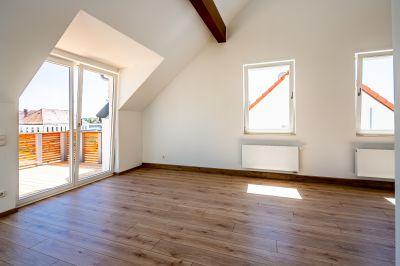 Abbildung: ein ausgebautes Dachgeschoss mit viel Freiraum…